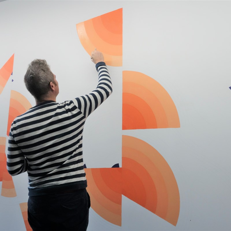 Ham Darroch creating wall work at Art Collective WA