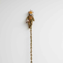 Olga Cironis, Yellow, 2019, repurposed toys, military fabric, feathers, plastic toy chain and thread, 148 x 17 x 12cm